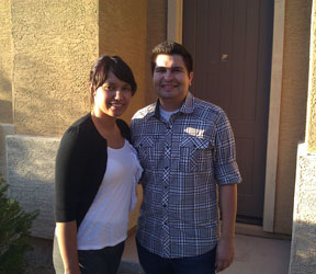 picture of a Phoenix husband and wife standing in front of their new home who recommend Phoenix Real Estate Agents Kristina and Ron Wilczek