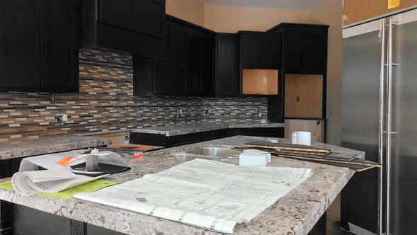 image of luxury home kitchen undergoing a complete renovation with top-of-the-line materials, which is somewhat unusual for a Phoenix real estate investment