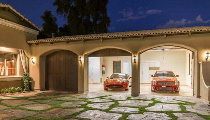 image of luxury home with multiple car garage bays